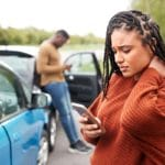woman holding neck after car accident - personal injury lawyers